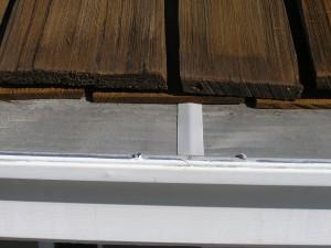 Gutterglove closeup on cedar roof